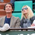 Vincent Cerutti et son amie lors du 6e jour du tournoi de Roland-garros, le vendredi 1er juin 2012.