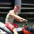 Sébastien Loeb ravi d'avoir un nouveau bolide entre les mains dans le port de Saint-Tropez le 23 juillet 2012