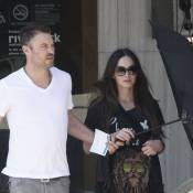 Megan Fox : Enceinte et dissimulée derrière un parapluie avec Brian Austin Green
