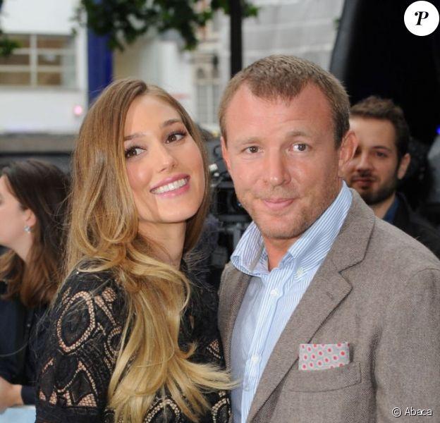 Guy Rtichie et sa fiancée Jacqui Ainsley lors de l'avant-première de The Dark Knight Rises à Londres - juillet 2012