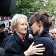 La femme de Claude Pinoteau, Birte, et Sophie Marceau lors des funérailles du réalisateur Claude Pinoteau à Paris le 11 octobre 2012
