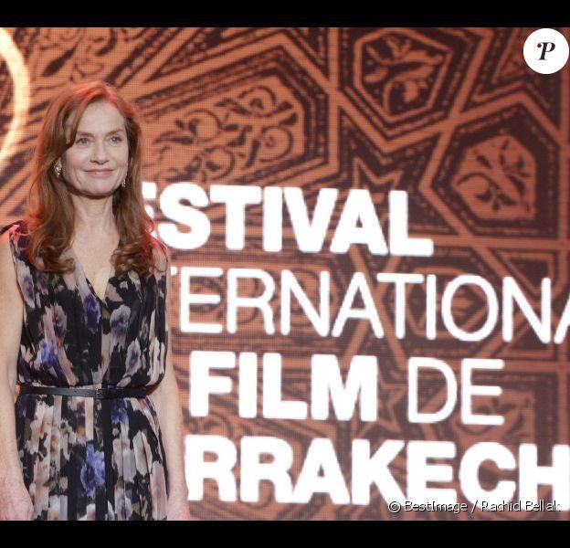 Isabelle Huppert, resplendissante, durant l'ouverture du Festival International du Film de Marrakech 2012, le 30 Novembre 2012.