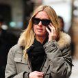 Nicky Hilton, shoppeuse stylée dans le quartier de SoHo à New York, pare au froid grâce à sa parka kaki qu'elle porte avec un slim gris et des baskets assorties Isabel Marant. Le 11 décembre 2012.
