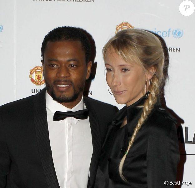 Patrice Evra et sa femme Sandralors du gala de l'UNICEF organisé par l'équipe de Manchester United à Manchester le 19 décembre 2012
