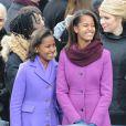 Sasha et Malia Obama lors de la cérémonie d'investiture de leur père qui se tenait devant le Capitole de Washington le 21 janvier 2013