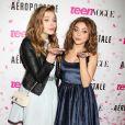 Chloë Grace Moretz et Sarah Hyland posent pendant le dixième anniversaire de Teen Vogue à l'Aeropostale de New York, le 7 février 2013.