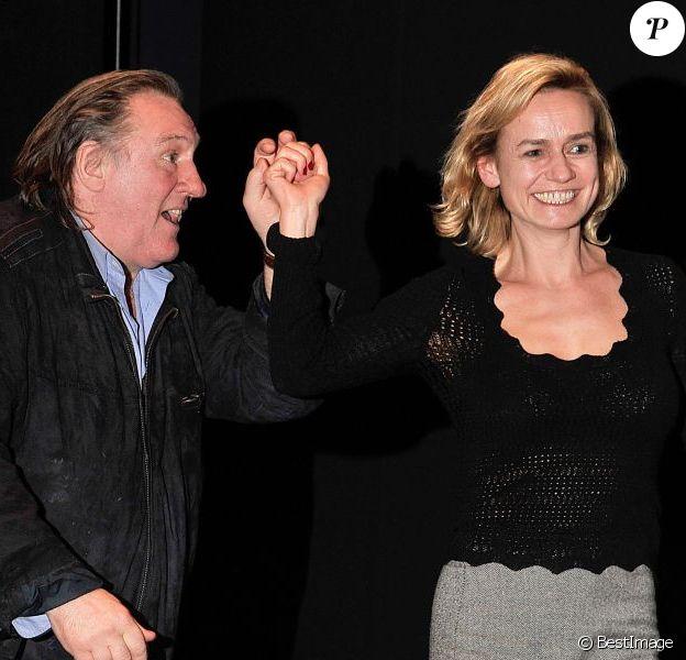 Gérard Depardieu et Sandrine Bonnaireau vernissage de l'exposition consacrée à Maurice Pialat à la Cinemathèque à Paris, le 18 février 2013.