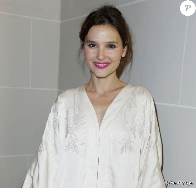 Virginie Ledoyen radieuse au défilé H&M qui avait lieu au musée Rodin à Paris le 27 février 2013