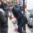 David Beckham et sa fille Harper dans les rues de Londres, le 18 mars 2013, au lendemain du match face à Saint-Etienne