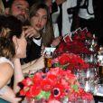 Charlotte Casiraghi et Gad Elmaleh amoureux pendant le dîner du Bal de la Rose, le 23 mars 2013 à Monaco, qui rendait cette année hommage aux 150 ans de la Société des Bains de mer. La princesse Caroline avait demandé à son ami Karl Lagerfeld d'orchestrer l'événement traversant le temps de la Belle Epoque à l'ère pop et habilement baptisé Belle et Pop.