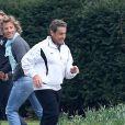 Nicolas Sarkozy décompresse avec un footing dans les allées du bois de Boulogne, à Paris, le 24 mars 2013.