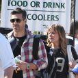 """""""LeAnn Rimes et son compagnon Eddie Cibrian vont assister au match de baseball de Jake, le fils d'Eddie, à Los Angeles, le 23 mars 2013. Le second fils d'Eddie, Mason, est également présent pour encourager son frère."""""""