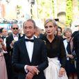 Bertrand Delanoë et Melita Toscan du Plantier à la montée des marches du film The Immigrant au Palais des Festivals à Cannes, le 24 mai 2013.