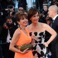 Victoria Abril et Kristin Scott Thomas pendant  la montée des marches du film The Immigrant au Palais des Festivals à Cannes, le 24 mai 2013.
