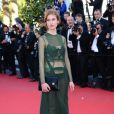 Agathe Bonitzer verte pour la montée des marches du film The Immigrant au Palais des Festivals à Cannes, le 24 mai 2013.