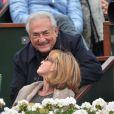 Dominique Strauss-Kahn et sa compagne Myriam L'Aouffir aux Internationaux de France de tennis de Roland-Garros le 9 juin 2013.