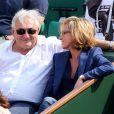 Dominique Strauss-Kahn et sa compagne Myriam L'Aouffir aux Internationaux de France de tennis de Roland-Garros le 8 juin 2013.