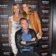 Sylvie Tellier et Sophie Thalmann avec Christophe Dechavanne à la soirée Sony Style à la boutique Sony (39 avenue George V), à Paris le 2 juillet 2013.