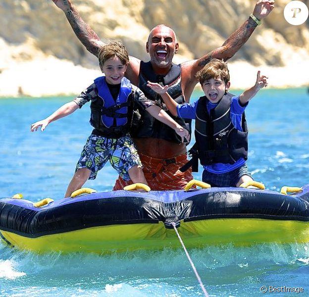 Exclusif - Christian Audigier en vacances avec ses trois enfants Rocco (10 ans), Dylan (8 ans) et Vito (5 ans)à Ibiza le 7 juillet 2013.