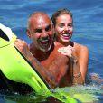 Exclusif - Christian Audigier en vacances avec sa sublime fiancée Nathalie Sorensen à Ibiza le 7 juillet 2013.