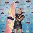 Miley Cyrus prend la pose en salle de presse à la cérémonie des Teen Choice Awards, à Los Angeles, le 11 août 2013.