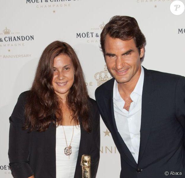 Marion Bartoli et Roger Federer lors des 270 ans de Moët & Chandon à New York le 20 août 2013.