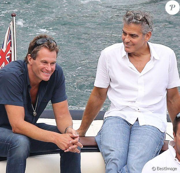 Exclusif - George Clooney et son ami Rande Gerber, complices, passent du bon temps en vacances, en balade en mer et détente chez Bono sur la côte d'Azur, à la villa d'Eze, le 19 août 2013.