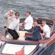 Exclusif - Bono salue un photographe avec George Clooney et son ami Rande Gerber en balade en mer sur la côte d'Azur, à la villa d'Eze, le 19 août 2013.