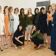 """""""Jeanne Yang et Katie Holmes, entourées de leurs mannequins lors de  la présentation la collection printemps-été 2014 de Holmes & Yang. New York, le 9 septembre 2013."""""""