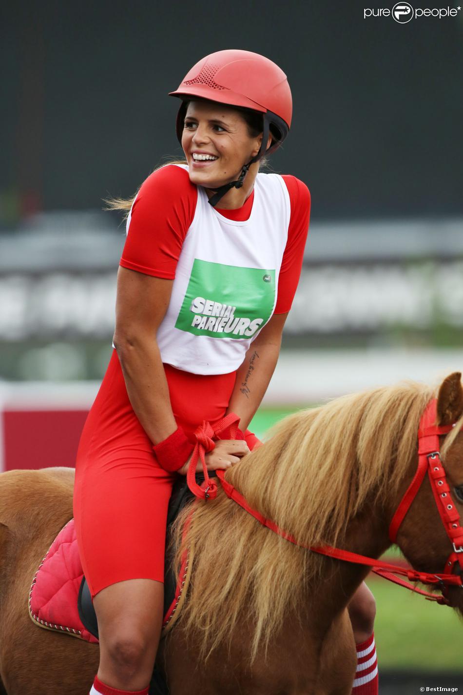 Laure Manaudou, parée pour la course Le Triomphe des Stars, organisée par le PMU et son opération Serial Parieurs, le 12 septembre 2013 à Paris