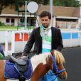Titoff paré pour la course Le Triomphe des Stars, organisée par le PMU et son opération Serial Parieurs, le 12 septembre 2013 à Paris
