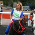 Ariane Brodier parée pour la course Le Triomphe des Stars, organisée par le PMU et son opération Serial Parieurs, le 12 septembre 2013 à Paris