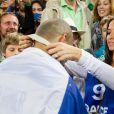 Tony Parker et sa fiancée Axelle après la finale de l'Eurobasket remportée par la France face à la Lituanie (80-66), à Ljubjana, le 22 septembre 2013