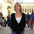 Michele Laroque arrive au défilé Vanessa Bruno à Paris le 27 septembre 2013