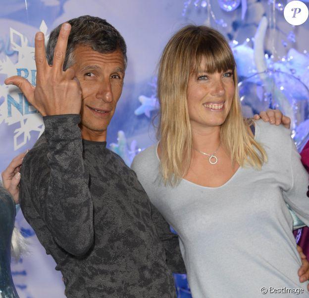 Nagui et sa femme, la jolie Melanie Page, découvrent le Noël Enchanté de Disneyland Paris, le 9 novembre 2013.