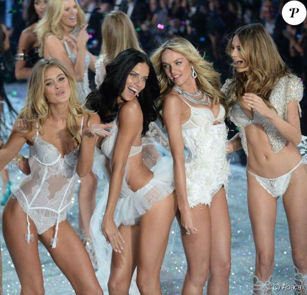 Karlie Kloss, Doutzen Kroes, Adriana Lima, Candice Swanepoel et Behati Prinsloo mènent le final du défilé Victoria's Secret à la 69th Regiment Armory. New York, le 13 novembre 2013.