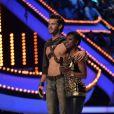 Florent Torres et Surya Bonaly durant le troisième prime d'Ice Show sur M6 à Paris, le 11 décembre 2013.