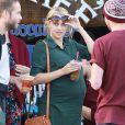 """""""Exclusif - L'actrice Teresa Palmer, enceinte, et son époux Mark Webber, se rendent au restaurant à Los Angeles, en compagnie des membres de leurs familles, le 27 décembre 2013."""""""