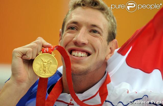 Alain Bernard medaille d'or au 100 metres nage libre a Pakin le 14 Aout 2008