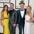 Jackie Ginger, Ryan Lewis, Macklemore et Tricia Davisarrivent au Staples Center pour la 56e édition des Grammy Awards. Los Angeles, le 26 janvier 2014.