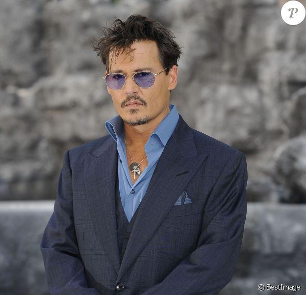 """Johnny Depp lors de l'avant-première du film """"Lone Ranger"""" à Londres, le 21 juillet 2013"""