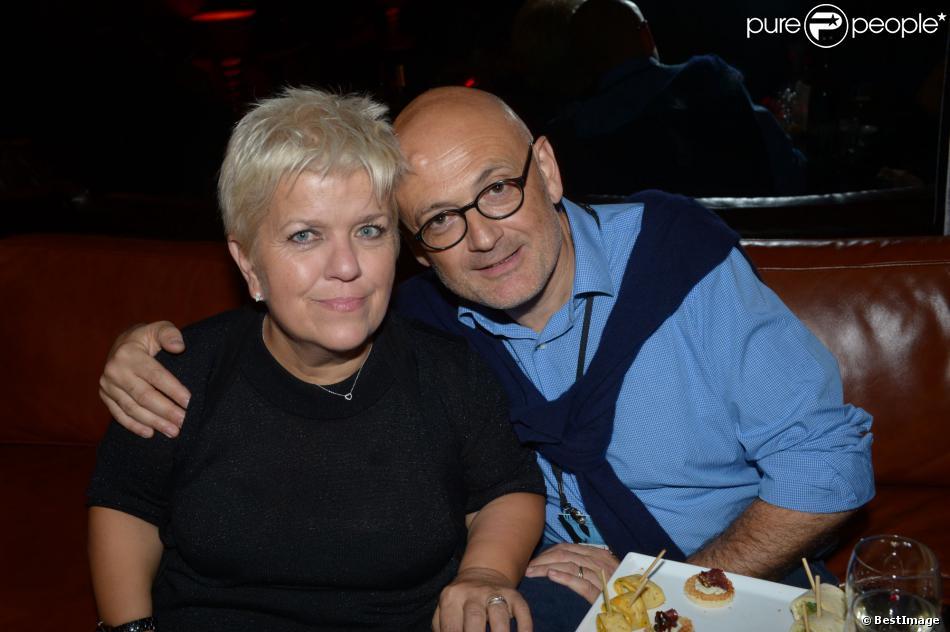 """Mimie Mathy et son mari lors de l'After Show des """"Enfoirés"""" chez Castel à Paris, le 28 janvier 2013."""