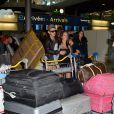 Micha et Kim de retour à Paris après le tournage de l'émission 'Les Marseillais a Rio' pour W9, le 6 mars 2014, à l'aéroport Roissy Charles de Gaulle.