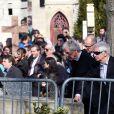 Constantin Costa-Gavras, Ivan Levaï - Obsèques d'Alain Resnais au cimetière du Montparnasse à Paris le 10 mars 2014.  Funeral of Alain Resnais at Montparnasse Cemetery on 10/03/2014.10/03/2014 - Paris