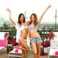Le top Alessandra Ambrosio et la belle Behati Prinsloo posent lors de la présentation de la nouvelle collection de maillots de bain Victoria's Secret à West Hollywood, le 11 mars 2014.