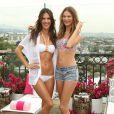 Alessandra Ambrosio et Behati Prinsloo posent lors de la présentation de la nouvelle collection de maillots de bain Victoria's Secret à West Hollywood, le 11 mars 2014.
