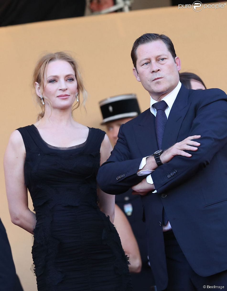 "Uma Thurman et Arpad Busson - Montée des marches du film ""The Immigrant"" lors du 66e festival du film de Cannes le 24 mai 2013"