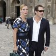 Uma Thurman et Arpad Busson à Paris pour le défilé Louis Vuitton le 5 octobre 2012