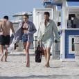Exclusif - Dree Hemingway et son compagnon Phil Winser quittent une plage de Miami après quelques heures de détente. Le 23 avril 2014.
