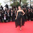 Natasha Poly   (robe Oscar de la Renta)  lors de la montée des marches du Festival de Cannes et la projection du film Saint Laurent le 17 mai 2014